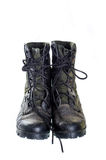 Old and dusty combat boots isolated on white. Stock Image