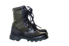 Old and dusty combat boots isolated on white. Royalty Free Stock Photo