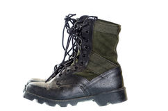 Old and dusty combat boots isolated on white. Royalty Free Stock Image