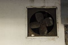 Old fan on the wall. stock photography