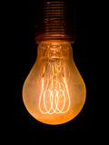 Old dusty light bulb. Glowing in the dark stock images
