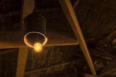 Old dusty light bulb glowing Stock Photography