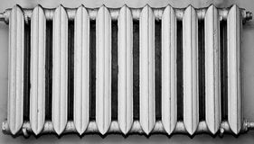 Old and dusty metal radiator. Monochrome colour Stock Image