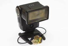 An old dusty National photographic flash unit from the film era that has been adapted for permanent use as a remote flash unit wit Royalty Free Stock Photography