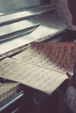 Old dusty notes on a vintage piano Royalty Free Stock Photos