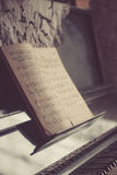 Old dusty notes on a vintage piano. Royalty Free Stock Image