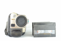 Old and dusty old Video camera and tapes from front Stock Images
