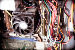 Old dusty pc cpu fan on motherboard Stock Images