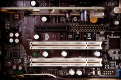 Old dusty pc motherboard detail, ram location Royalty Free Stock Images