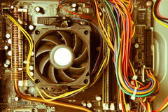 Old dusty pc motherboard vintage color effect Stock Photography