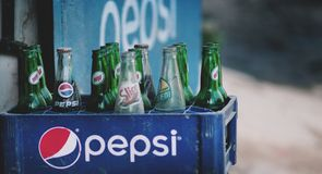Old Dusty Pepsi Bottles on Plastic Crate Sold At Thamel Street. Editorial Royalty Free Stock Images