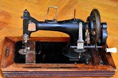 Old dusty retro mechanical sewing machine royalty free stock photos