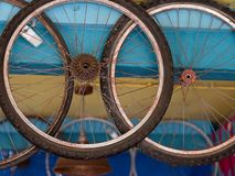 Dirty wheels hanging from the colorful ceiling. royalty free stock images