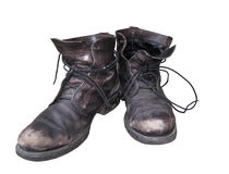 Old dusty shoes isolated. Royalty Free Stock Images
