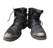 Old dusty shoes isolated. Royalty Free Stock Image