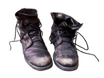 Old dusty shoes isolated. Stock Photo