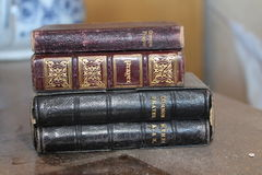 Old dusty stack of Prayer books Stock Photo