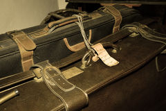 Old dusty suitcases. Vintage baggage Stock Photo