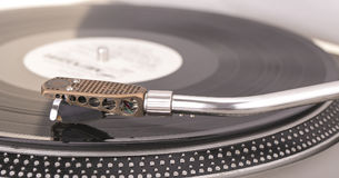 Old dusty vinyl turntable player  over white background. Stock Image