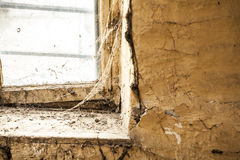 Old dusty window in the wall with cobweb Stock Photos