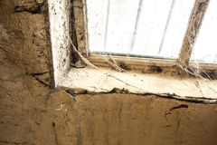 Old dusty window in the wall with cobweb Stock Photography