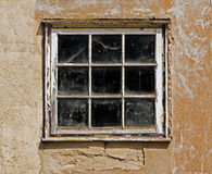 Old dusty window in the wall of house Stock Images