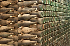 Old and dusty wine bottles in cellar Stock Photography