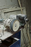 Old dusty workshop. With grip vice and grinder Stock Images