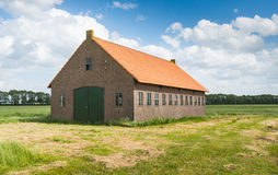 Old Dutch Barn Of Brick Masonry With An Orange Tile Roof Stock Photography