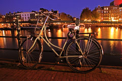 Old dutch bike  in Amsterdam in Netherlands. Old dutch bike at the Amtel in Amsterdam in the Netherlands by night Stock Image