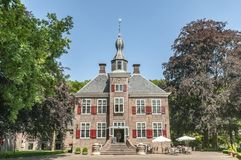 Old Dutch castle annex hotel harderwijk. Old Dutch castle annex hotel surrounded by trees at the Dutch town of Harderwijk Royalty Free Stock Photography