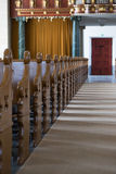 AncientDutch church interior. Church interior, the ile with seats on one side Royalty Free Stock Photos