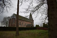Old Dutch church in a small village. An old Dutch church in the middle of a small village royalty free stock photo
