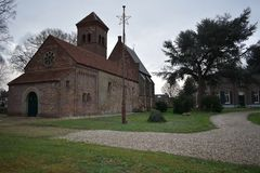 Old Dutch church in a small village. Old Dutch church in the middle of a small village royalty free stock photography