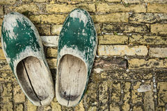 Old Dutch clogs on a brick background Royalty Free Stock Images