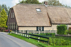 Old Dutch farm with grocery garden Stock Photos