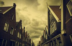 Old Dutch houses. Detail of tourism in Europe netherlands traditional holland architecture ancient building historic amsterdam volendam village heritage brick stock photo