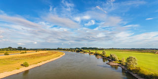 The old Dutch river IJssel in the province of Gelderland. Panoramic image of the old Dutch river IJssel in the province of Gelderland Royalty Free Stock Photography