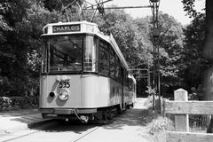 Old dutch tram driving. Old dutch tram in black and white Royalty Free Stock Image