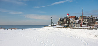 Old dutch village in wintertime. Old dutch fishery village seen in wintertime from the beach royalty free stock image