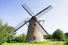 Old dutch windmill. Old dutch stone windmill on a meadow Royalty Free Stock Images