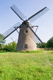 Old dutch windmill. Old dutch stone windmill on a meadow Stock Photography
