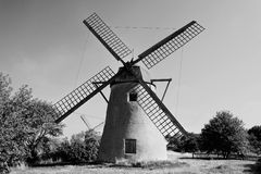 Old dutch windmill in black and white. Old dutch stone windmill on a meadow in black and white Stock Image