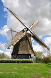 Old Dutch windmill in a green field Royalty Free Stock Photo