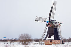 Old dutch windmill in a winter landscape Royalty Free Stock Photography