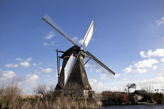 The old Dutch windmills, Holland, rural expanses . Windmills, the symbol of Holland. Holland windmill on a canal. Old mill chalk and flour . The beautiful Stock Photo
