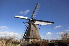 The old Dutch windmills, Holland, rural expanses . Windmills, the symbol of Holland. Holland windmill on a canal. Old mill chalk and flour . The beautiful Royalty Free Stock Photography