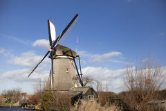 The old Dutch windmills, Holland, rural expanses . Windmills, the symbol of Holland. Holland windmill on a canal. Old mill chalk and flour . The beautiful Royalty Free Stock Image