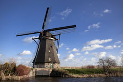 The old Dutch windmills, Holland, rural expanses . Windmills, the symbol of Holland. Holland windmill on a canal. Old mill chalk and flour . The beautiful Stock Photography