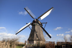 The old Dutch windmills, Holland, rural expanses . Windmills, the symbol of Holland. Holland windmill on a canal. Old mill chalk and flour . The beautiful Stock Photos